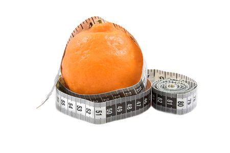 Orange naartjie with measuring tape on white background. Copy space. photo