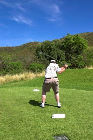 Golfer swinging the club. Golf club is in motion. photo