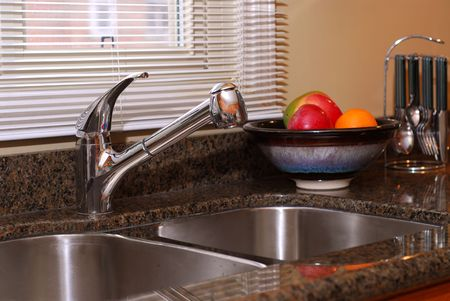 Interior of a modern kitchen with granite counter top and stanless steel double sink Stock Photo - 811103