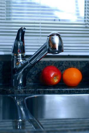 Detail of a modern kitchen inter with granite counter top and stanless steel double sink Stock Photo - 811102