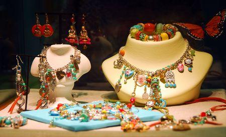 Fashion jewelry displayed in a jewelry store window photo