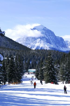 Downhill skiing in Canadian Rocky mountains with scenic view photo