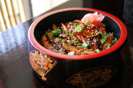 Gourmet japanese food barbequed eel served in a decorated wooden bowl