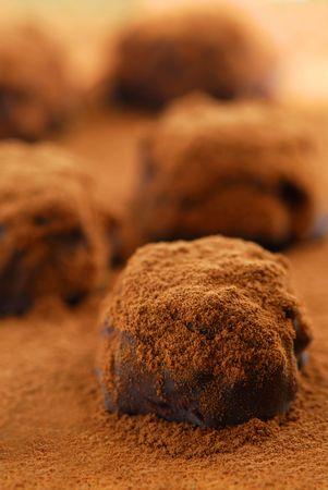 indulgent: Macro image of dark chocolate truffles sprinkled with cocoa powder