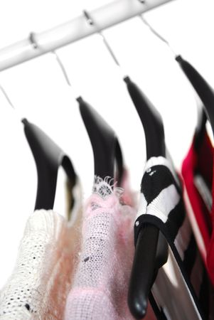 garb: Womens clothing on a rack on black hangers