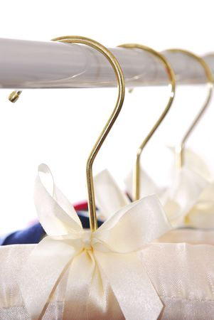 Luxury padded dress hangers on a clothes rack Stock Photo - 865768