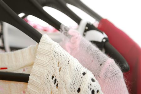 hangers: Womens clothing on a rack on black hangers