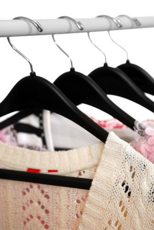 womens clothing: Womens clothing on a rack on black hangers