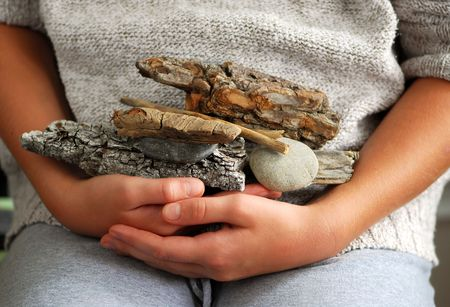 collected: Child hands holding beach treasures collected on sea shore Stock Photo