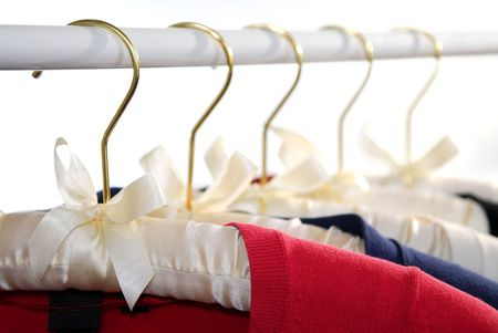 hangers: Colorful womens sweaters on a rack on padded hangers