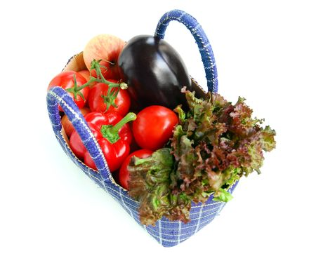 Fresh vegetables and fruits in a basket isolated on white background photo