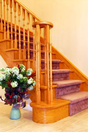 Interior of a house hallway with solid wood staircase photo