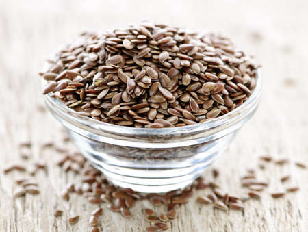 linseed: Bowl full of brown flax seed or linseed