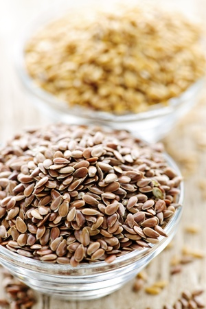 nutriment: Bowls full of brown and golden flax seed or linseed