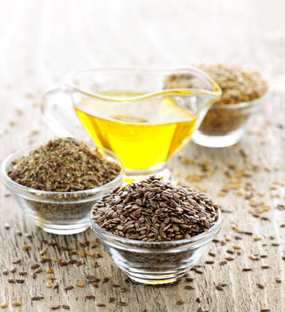 linseed: Bowls of whole and ground flax seed with linseed oil Stock Photo