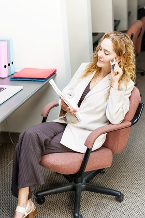 cubby: Businesswoman thinking of ideas in office workstation