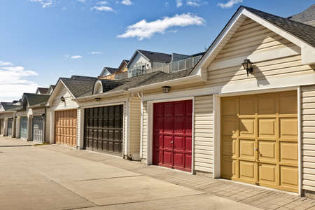 townhouses: Row of garage doors at parking area for townhouses