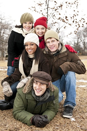 Group of young friends having fun outdoors in winter Stock Photo - 20785480