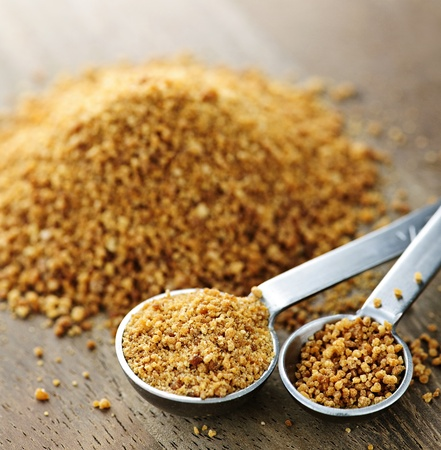 coconut palm sugar: Organic coconut palm sugar in measuring spoons Stock Photo