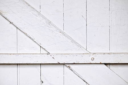 painted wood: Background of old wooden barn door painted white