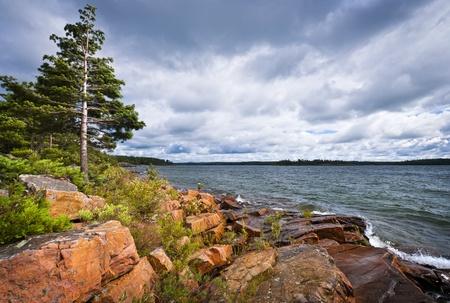 georgian: Rocky lake shore of Georgian Bay in Killbear provincial park near Parry Sound, Ontario, Canada.