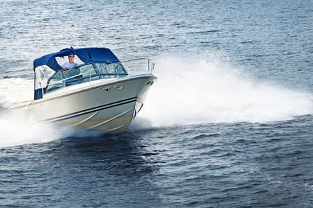 boating: Man piloting motorboat on lake in Georgian Bay, Ontario, Canada. Stock Photo