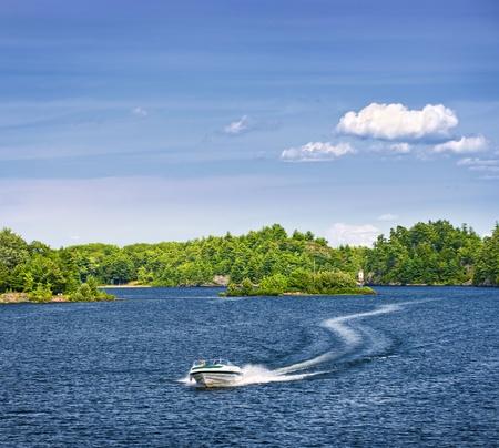 pleasure boat: Woman piloting motorboat on lake in Georgian Bay, Ontario, Canada
