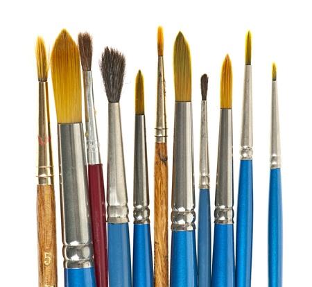Various sizes of paintbrushes on white background photo