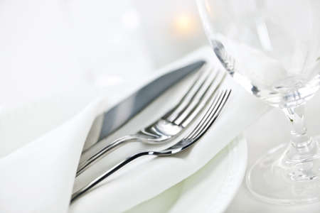 fine dining: Elegant restaurant table setting for fine dining with plates cutlery and stemware
