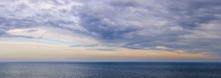 vast: Panoramic view of dramatic sunset sky over vast ocean Stock Photo
