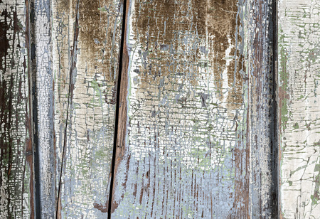 Background of old aged wood boards with peeling paint photo