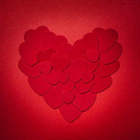 smaller: Romantic heart made of many smaller red paper hearts for valentines day Stock Photo