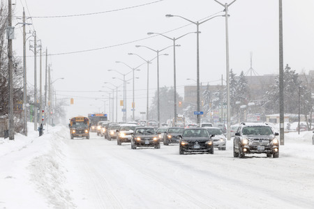 cope: TORONTO, CANADA � FEBRUARY 5, 2014  Traffic on Kingston Road during winter snowstorm on Wednesday, February 5, 2014 in Toronto  Drivers cope with hazardous conditions during the 2014 polar vortex