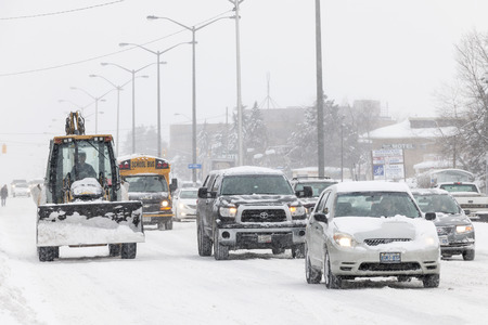 cope: TORONTO, CANADA – FEBRUARY 5, 2014  Traffic on Kingston Road during winter snowstorm on Wednesday, February 5, 2014 in Toronto  Drivers cope with hazardous conditions during the 2014 polar vortex