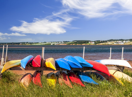 Colorful kayaks stored on Atlantic shore in North Rustico, Prince Edward Island, Canada Stock Photo - 27340246