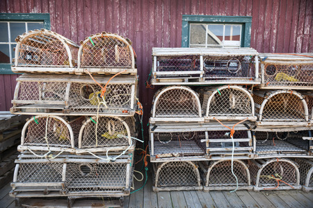 edward: Stacks of wooden lobster traps in North Rustico, Prince Edward Island, Canada.