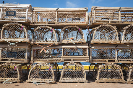 Stacks of wooden lobster traps on pier in North Rustico, Prince Edward Island, Canada. photo