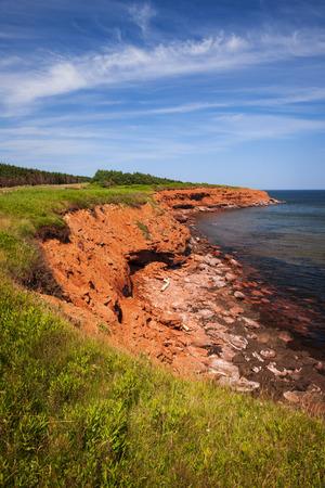 gables: Red cliffs of Prince Edward Island Atlantic coast in Green Gables Shore, PEI, Canada.