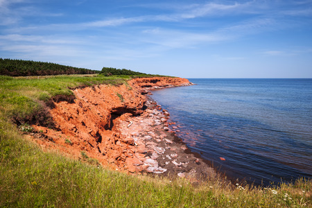 gables: Red cliffs of Prince Edward Island Atlantic coast in Green Gables Shore, PEI, Canada.