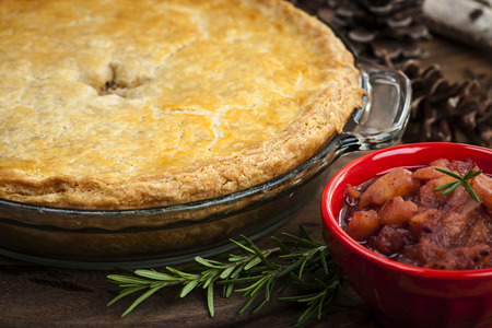 meat pie: Traditional pork meat pie Tourtiere with apple and cranberry chutney from Quebec, Canada. Stock Photo