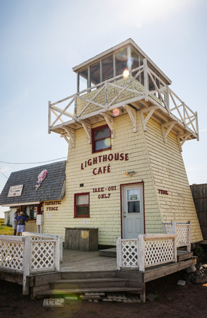 quaint: NORTH RUSTICO, PRINCE EDWARD ISLAND, CANADA JULY 15, 2013: Lighthouse Cafe serves unidentified tourists in village of North Rustico.