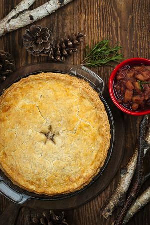 Traditional pork meat pie Tourtiere with apple and cranberry chutney from Quebec, Canada, top view