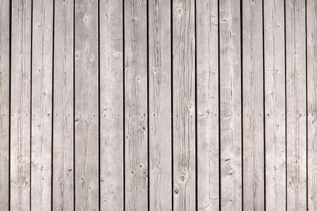 Background of old wooden weathered unpainted deck planks photo