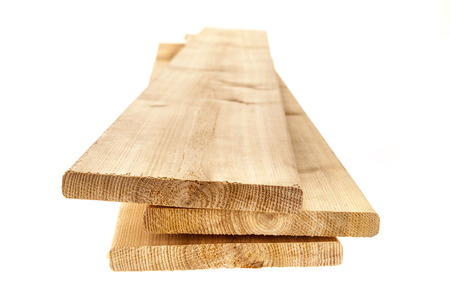 floorboards: Three cedar one by six inch wood planks on white background