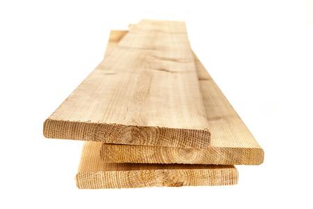 cedar: Three cedar one by six inch wood planks on white background
