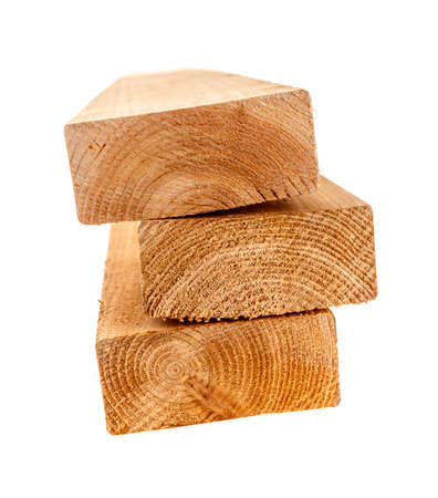 stud: Edge of three cedar two by four wood boards on white background Stock Photo