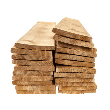 heap: Stacks of one by six inch cedar boards on white background Stock Photo