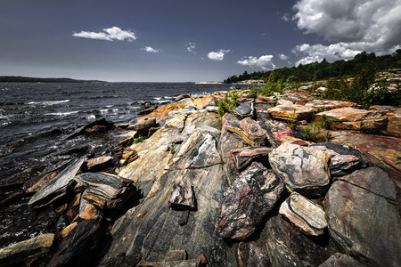 bedrock: Georgian Bay landscape with rugged rocky lake shore near Parry Sound, Ontario, Canada.