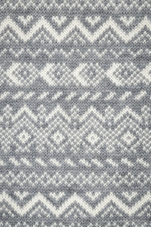 close knit: Knit fabric background with knitted grey and white geometric pattern