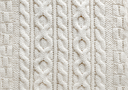 cable knit: Knit texture of light natural wool knitted fabric with cable pattern as background
